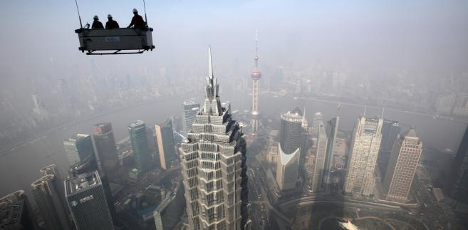 Widok na Szanghaj z najwyższych pięter budynku Shanghai World Financial Center. Fot. Tomohiro Ohsumi, Bloomberg's Best Photos 2013.